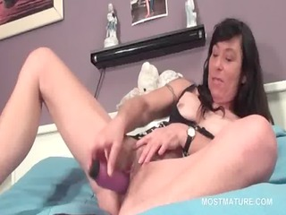 aged hooker fucks her vagina with sex tool