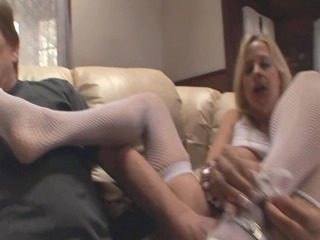 two blondes giving a kinky footjob in nylons