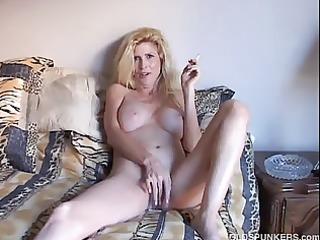glamorous blond mother i enjoys a smoke break