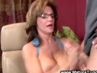 mature lady massaging a ramrod
