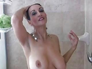 brunette milf with big wobblers masturbates under