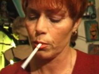 kira red aged german plumper smokes a cigarette