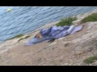 my wife sleeping at the beach