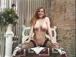 mature floozy undresses to show off her nice ass