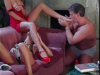 businessman licking two whores feet