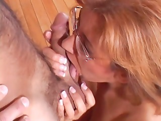 mature broad in glasses takes facial after wild