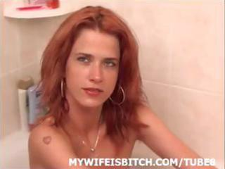 skinny redhead wife is in the tub posing and