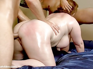 milf is oiled and fucked by 8 muscle bound studs