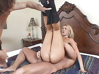 nice-looking blond takes cocks at once, a huge