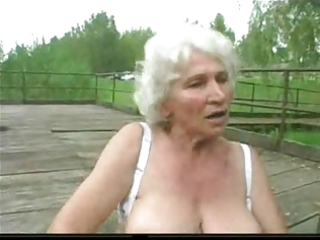 granny norma outdoors with big toys and a engulf