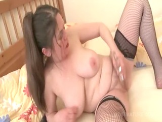 older in fishnets reaches orgasm with fake penis